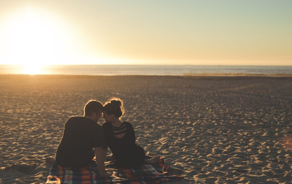 Couple dating with confidence at the beach