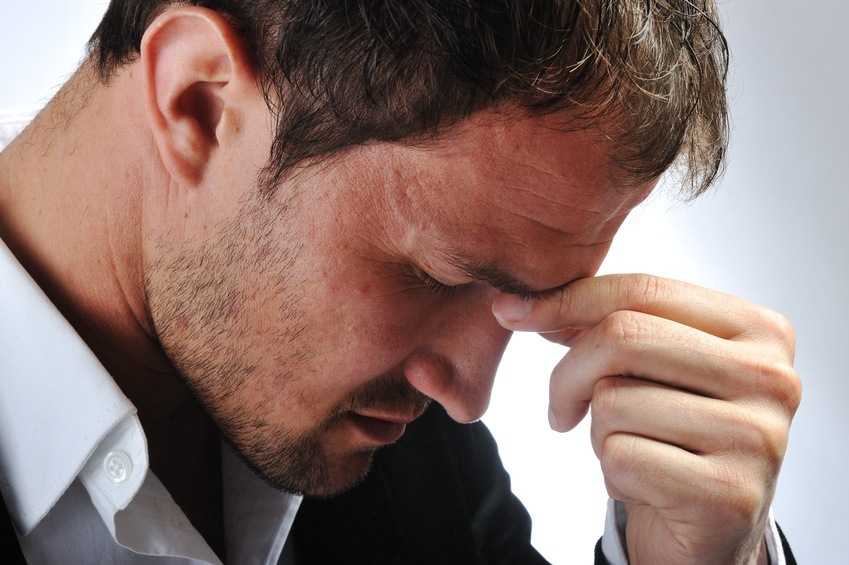 Man showing signs of stuck emotions